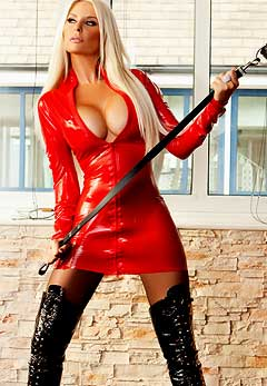 Mature blonde dominatrix in leather something